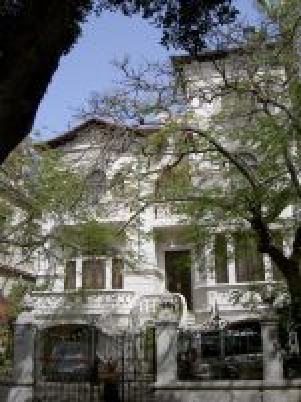 Art Nouveau architecture behind a Henry Moore street art on the Rambla Santa Cruz.