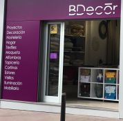 B Decor with its list of services on the shop front for Design, such as Interior Decoration