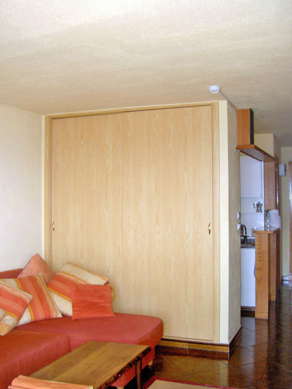 Large built in wardrobe with sliding doors to save space.