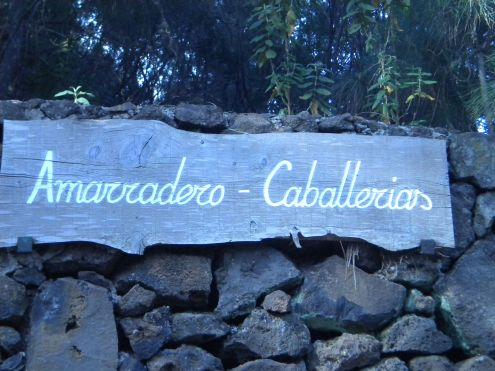 Amarradero Caballerias horse parking wall in the forest.