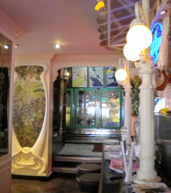 Art Nouveau decor on walls, by architectural details and lighting in Parisian cafe of Tenerife North.