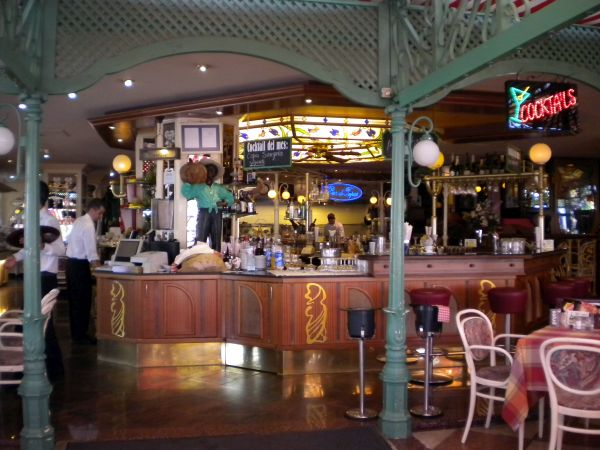 Art Nouveau interior with typical Tiffany lighting depicted by bar and cafe all in one.