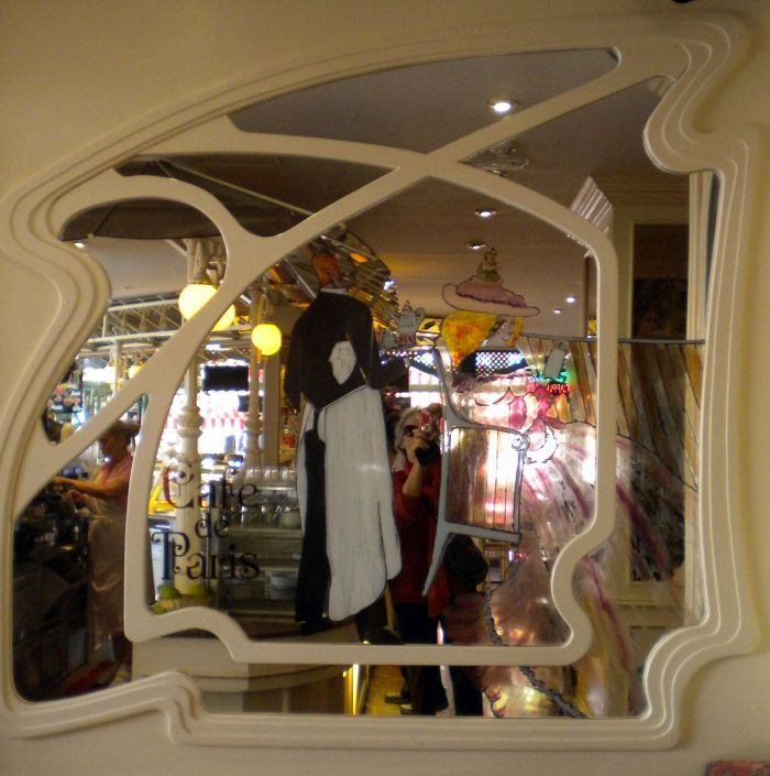 Art Nouveau mirror and mirror image of Puerto de la Cruz Cafe Paris interior reflected in it.