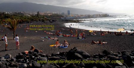 Black beach with volcanic rocks and pebbles Playa Jardin San Felipe