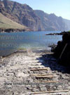Rustic boat ramp behind cliffs of Los Gigantes