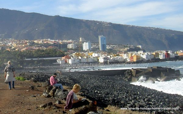 breakwaters of Playa Jardin and Puerto Cruz town