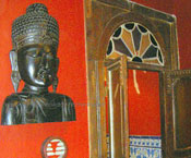 Buddha relief on the wall in retro restaurant Tenerife