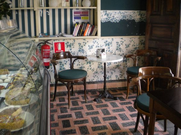 Cafe with book corner for you to read at the premises without charge.