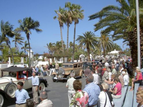 Car rally under palms during carnival in Puerto de la Cruz Tenerife Spain.