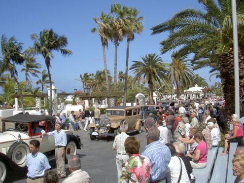 Car rally under palms during carnival in Puerto de la Cruz Tenerife Spain.