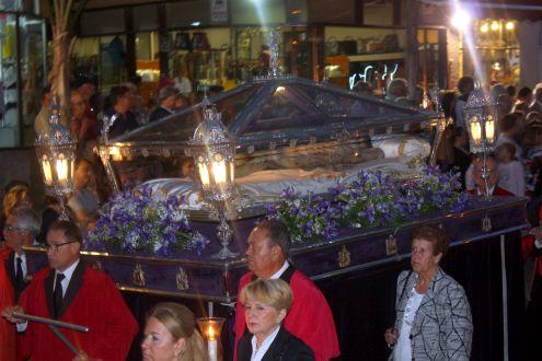 Christ in Glass coffin lying down.