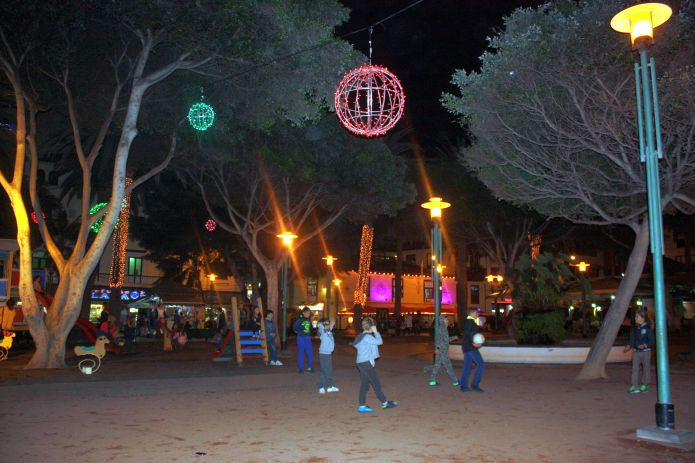 Christmas ballgame under stars with led light  illumination on Plaza del Charco.