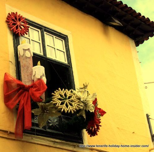 Christmas decoration close-up on the corner window of the same restaurant