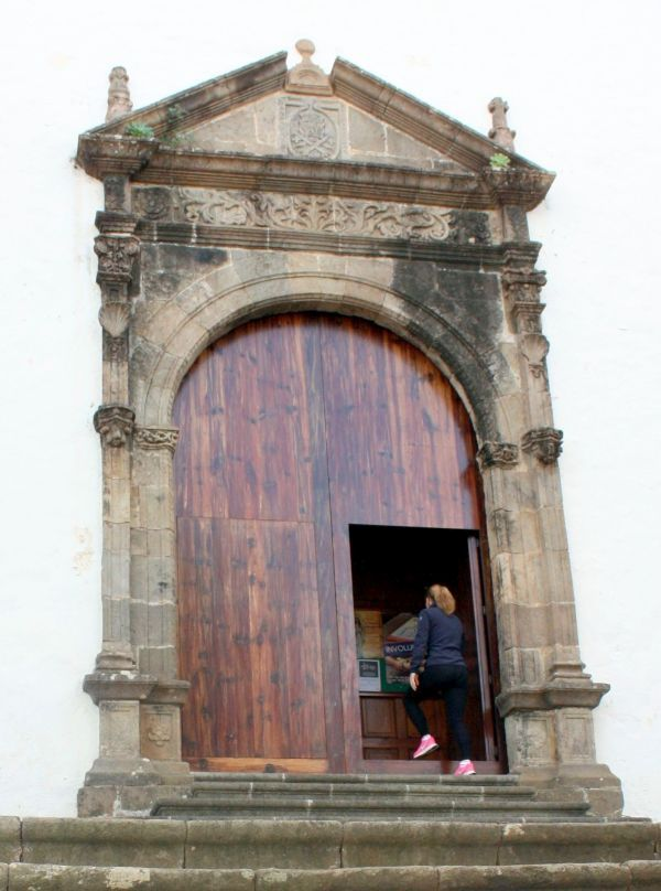 Church alternative entrance of 16th century built with Renaissance decor masonry above it.