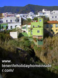Cliff houses above deep gorge Barranco Palo Blanco by  Calle Los Barros Tenerife North.