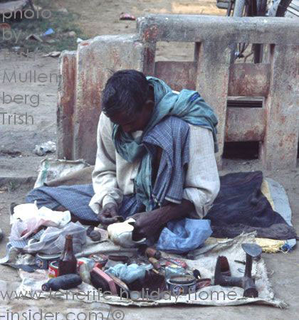 cobbler with workshop on pavement