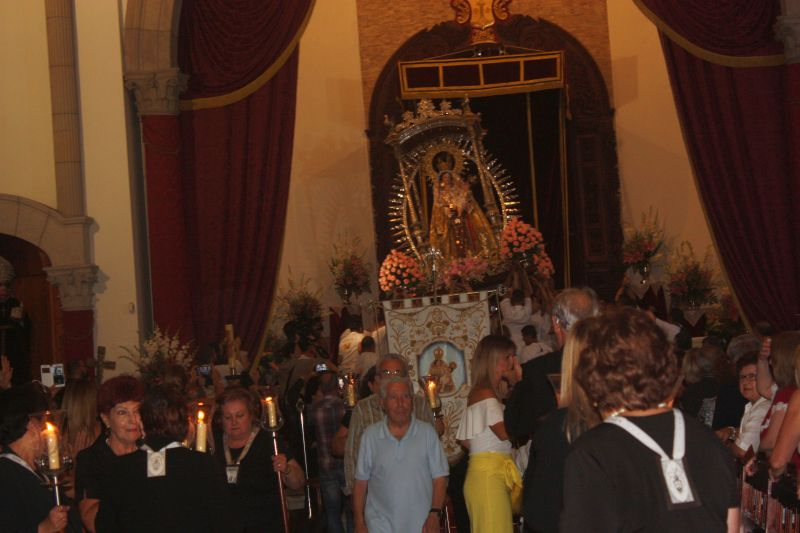 Commotion by the altar where Marinos take down the Madonna, onto their shoulders.