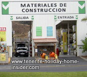 Construction material  with drive in gate by Tenerife main road
