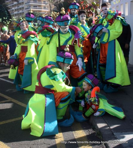 Costa Martianez Carnival with men and child in green robes.