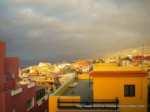 Crazy February weather with warm sun under black skies over Toscal La Longuera above Puerto de la Cruz.