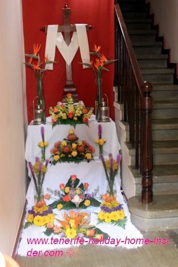 Cross decoration with bright colors in house entrance hall.