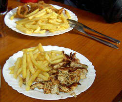 Cuban cuisine chicken dish with French fries all for Euro 2