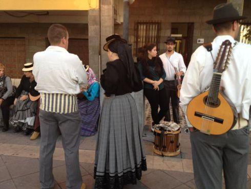 Dia de Canaria folk musicians assembling by a town hall.
