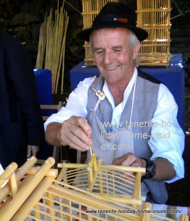Domingo Suarez Ortega of Gran Canaria making bird cages of cane.