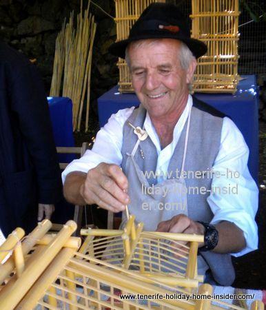 Domingo Suarez Ortega of Gran Canaria making bird cages of cane.