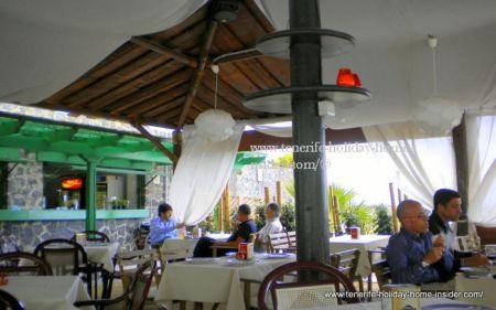 Eating at la ABadia Santa Cruz inside