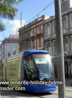 An electric tram called a Tranvia near the port of the Tenerife capital Tenerife behind Plaza de Espana