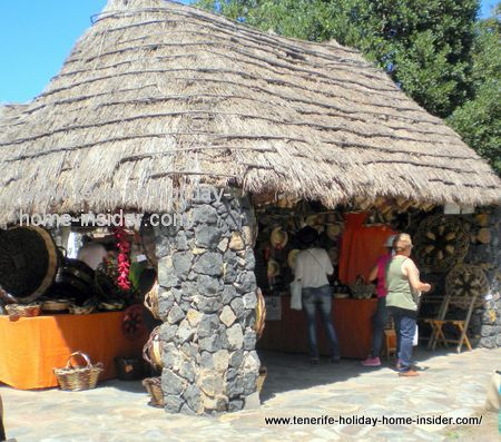 Ethnographic hut open on two sides with baskets for sale