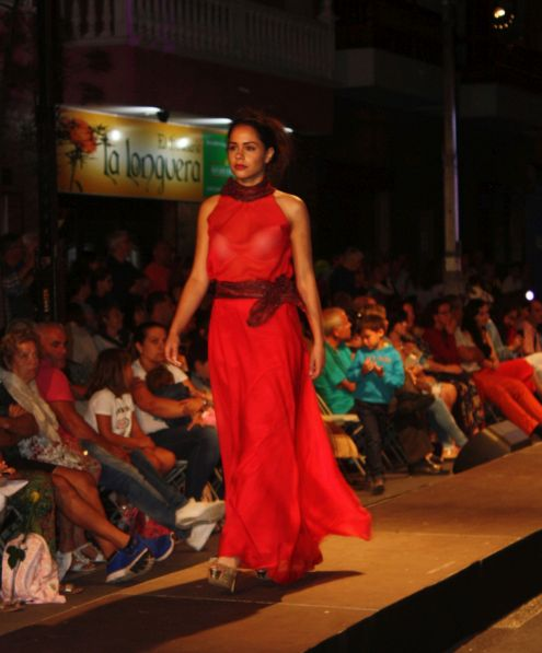 Red evening dress that almost covers the shoes