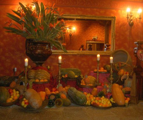 Farm decoration of harvest bounty with Strelitzias, fruit, pumpkins and Gourds.