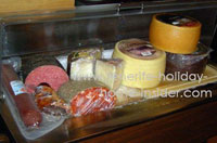 classic groceries for tapas, like different cheese, hams and salamis