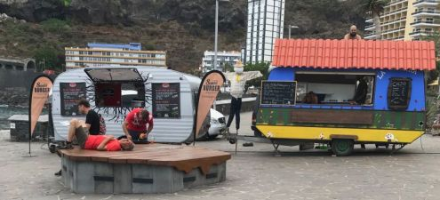Food trucks on tour during Tenerife festivals of the mobile truck on August 17 of 2018 at Martianez in Puerto de la Cruz