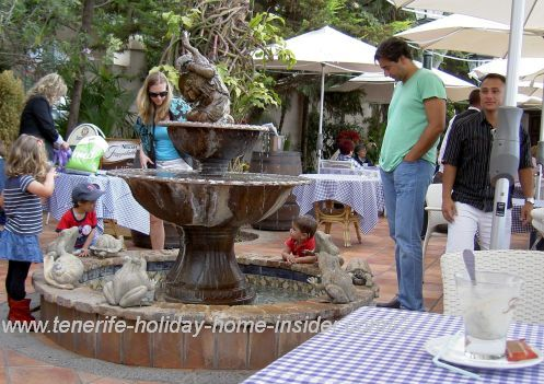 Fountain fun for free for toddlers by a restaurant with views at el Monasterio.