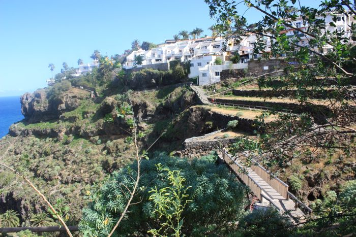 Gordejuela gorge or gorge Barranco de  Palo Blanco with hamlet Romantica-1, ocean, Rambla path ways and bridge.