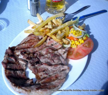 Grilled pork with smoky taste, French Fries and salad