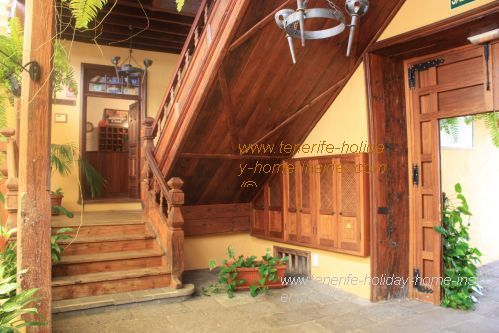 Hotel Rural Bentor lobby with antique timber stairs to its Reception room.