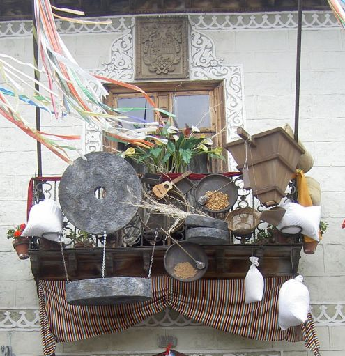 Household items pots and pans of olden days from the North Tenerife apartment Casa de los Balcones displayed on its balcony during a Tenerife Fiesta