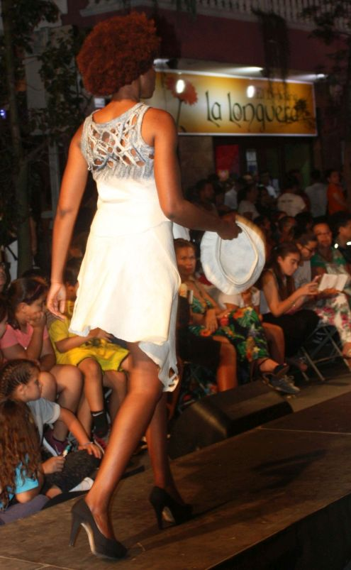 Interesting design of white dress worn by a beautiful African model