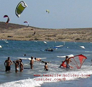 Surfing with kites above the ocean el Medano