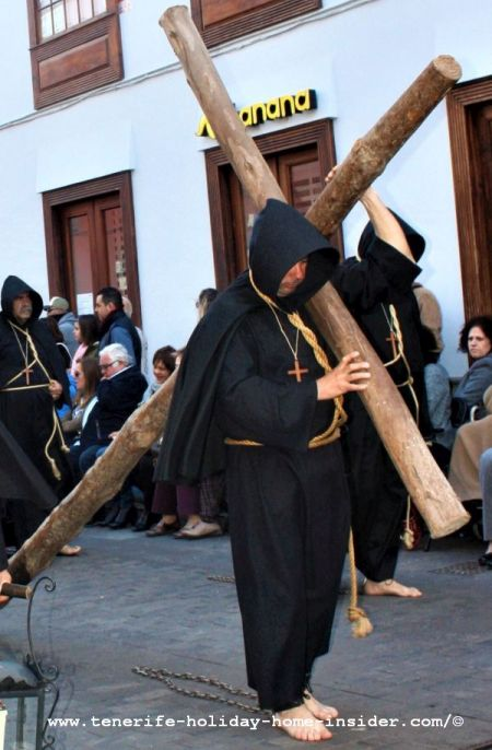 La Laguna penitent with a rough timber cross made by a tree a tradition that isn't heard of anymore in other parts of Spain