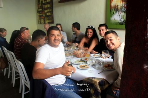 Happy La Laguna university students celebrating Christmas Eve lunch in 2016 at the Hierbita.