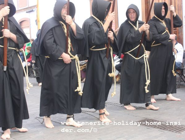 La Laguna Tenerife Easter penitents whose bare feet are chained together which also isn't the norm during the entire good Friday procession