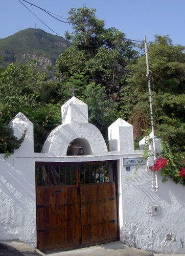 La Parra Alta Portal with its unique bell gable of the conqueror's estate by the town square Plaza San Sebastian.