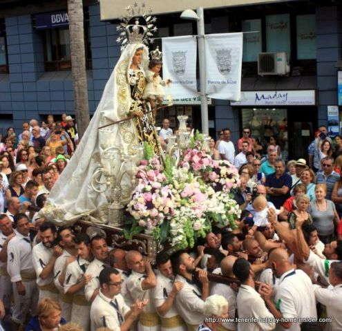 Lady of Carmel carried by seamen and fishermen during a street procession.