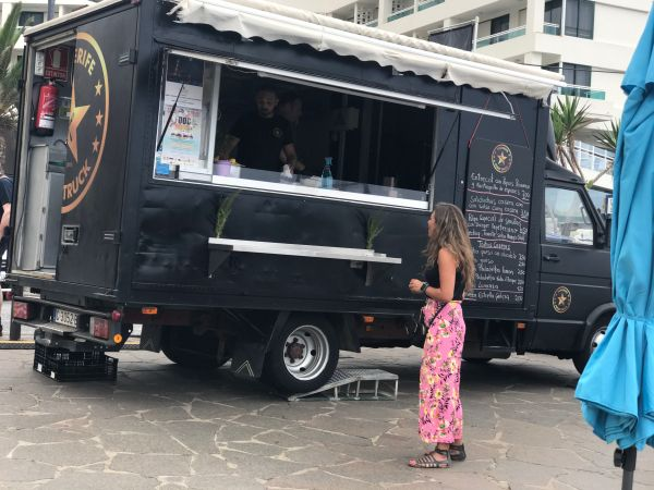 A 5-ton food vehicle with an open shopfront at Playa Martianez of Puerto de la Cruz in Tenerife Spain