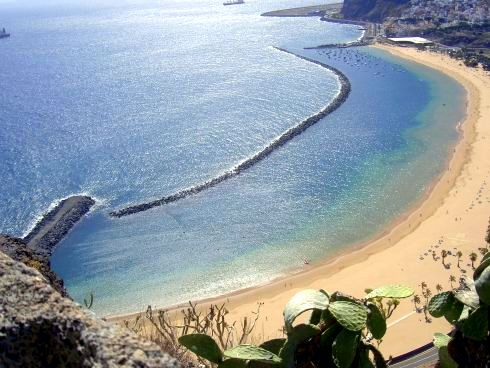 Tenerife beaches Playa Las Teresitas with its three breakwaters for safe swimming.